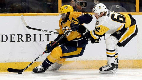 Nashville Predators defenseman P.K. Subban, left, tries to skate past Pittsburgh Penguins left wing Carl Hagelin, of Sweden, right, during the second period in Game 3 of the NHL hockey Stanley Cup Finals Saturday, June 3, 2017, in Nashville, Tenn. (AP Photo/Mark Humphrey)