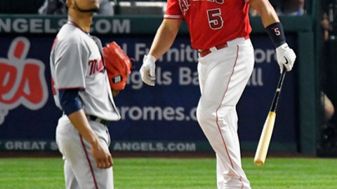 Los Angeles Angels' Albert Pujols, right, watches his solo home run, the 600th homer of his career, off Minnesota Twins starting pitcher Ervin Santana, front, during the fourth inning of a baseball game, Saturday, June 3, 2017, in Anaheim, Calif. (AP Photo/Mark J. Terrill)
