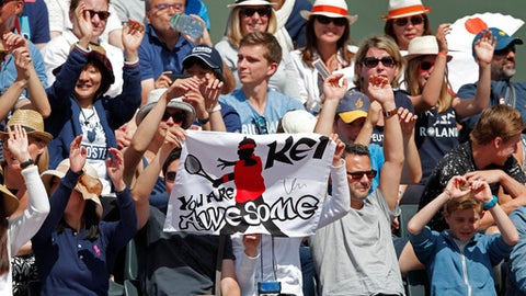 Supporters of Japan's Kei Nishikori cheer as he plays against Korea's Hyeon Chung during their third round match of the French Open tennis tournament at the Roland Garros stadium, in Paris, France. Sunday, June 4, 2017. (AP Photo/Christophe Ena)