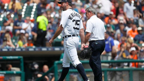 Detroit Tigers pitcher Justin Verlander (35) leaves the game with trainer Kevin Rand against the Chicago White Sox in the third inning of a baseball game in Detroit, Sunday, June 4, 2017. (AP Photo/Paul Sancya)