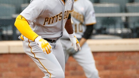 Pittsburgh Pirates' Andrew McCutchen watches his ninth-inning three-run home run in a baseball game against the New York Mets, Sunday, June 4, 2017, in New York. (AP Photo/Kathy Willens)