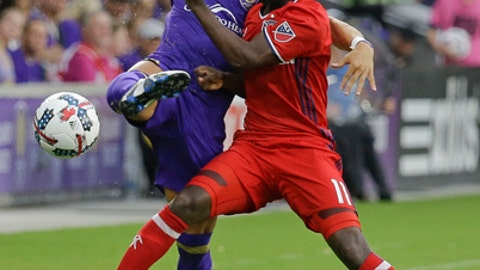 Orlando City's Rafael Ramos, left, and Chicago Fire's David Accam (11) become entangled while going for the ball during the first half of an MLS soccer game, Sunday, June 4, 2017, in Orlando, Fla. (AP Photo/John Raoux)