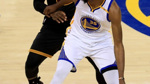 OAKLAND, CA - JUNE 04: Kevin Durant #35 of the Golden State Warriors is defended by LeBron James #23 of the Cleveland Cavaliers during the second half of Game 2 of the 2017 NBA Finals at ORACLE Arena on June 4, 2017 in Oakland, California. NOTE TO USER: User expressly acknowledges and agrees that, by downloading and or using this photograph, User is consenting to the terms and conditions of the Getty Images License Agreement.  (Photo by Ronald Martinez/Getty Images)