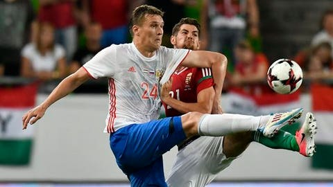 Aleksander Bukharov of Russia, left, and Barnabas Bese of Hungary fight for the ball during the international friendly soccer match between Hungary and Russia at the Goupama Arena in Budapest, Hungary, Monday, June 5, 2017. (Tibor Illyes/MTI via AP)
