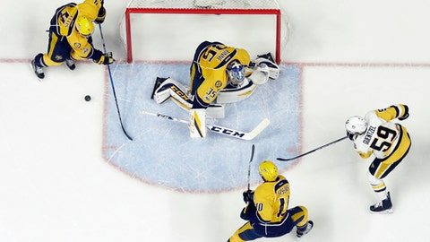 Pittsburgh Penguins' Jake Guentzel, right, watches as a puck slides past Nashville Predators goalie Pekka Rinne, of Finland, Colton Sissons (10) and Ryan Ellis, left, during the first period in Game 4 of the NHL hockey Stanley Cup Finals Monday, June 5, 2017, in Nashville, Tenn. (AP Photo/Mark Humphrey)
