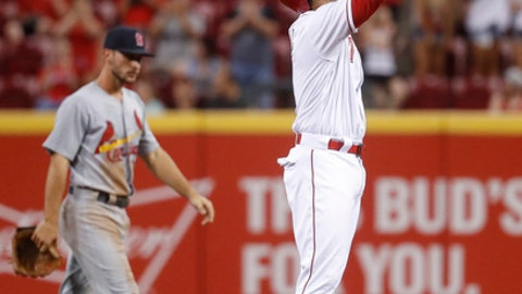 Cincinnati Reds' Eugenio Suarez reacts after hitting a game-tying two-run double off St. Louis Cardinals starting pitcher Carlos Martinez in the seventh inning of a baseball game, Monday, June 5, 2017, in Cincinnati. (AP Photo/John Minchillo)