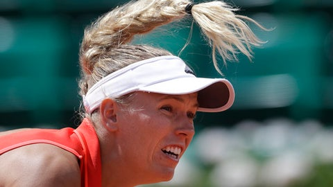 Denmark's Caroline Wozniacki serves against Latvia's Jelena Ostapenko during their quarterfinal match of the French Open tennis tournament at the Roland Garros stadium, in Paris, France. Tuesday, June 6, 2017. (AP Photo/Petr David Josek)