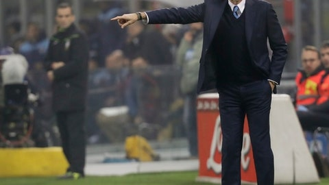 FILE - In this Wednesday, Dec. 21, 2016 file photo, Inter Milan coach Stefano Pioli gives indications during a Serie A soccer match between Inter Milan and Lazio, at the San Siro stadium in Milan, Italy. Recently fired Inter Milan coach Stefano Pioli has been appointed to take over Fiorentina. The two-time Serie A champion made the announcement Tuesday, June 6, 2017 saying Pioli has signed a two-year contract with an option for a third season. Pioli replaces Paulo Sousa, whose contract was not renewed. (AP Photo/Luca Bruno, File)