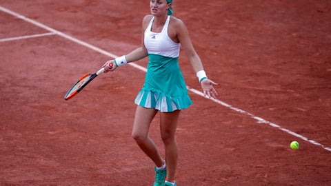 France's Kristina Mladenovic reacts as she plays Timea Bacsinszky of Switzerland during their quarterfinal match of the French Open tennis tournament at the Roland Garros stadium, Tuesday, June 6, 2017 in Paris. (AP Photo/Michel Euler)