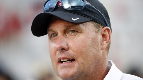 FILE - In this Saturday, Sept. 10, 2016 file photo, Mississippi head coach Hugh Freeze speaks with a reporter about the team's 38-13 win over Wofford in their NCAA college football game in Oxford, Miss. The University of Mississippi has contested the NCAA's charges of lack of institutional control and failure to monitor by head coach Hugh Freeze. The Ole Miss football program released its response Tuesday, June 6, 2017 to a second NCAA Notice of Allegations in less than two years. The first NOA alleged 13 violations while the second added eight more, bringing the total to 21. (AP Photo/Rogelio V. Solis, File)
