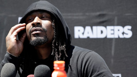 Oakland Raiders running back Marshawn Lynch fields questions after the team's organized team activity at its NFL football training facility Tuesday, June 6, 2017, in Alameda, Calif. (AP Photo/Marcio Jose Sanchez)