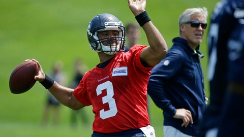 Seattle Seahawks starting quarterback Russell Wilson passes during NFL football practice, Tuesday, June 6, 2017, in Renton, Wash. (AP Photo/Ted S. Warren)