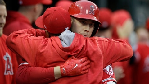 Los Angeles Angels' C.J. Cron is congratulated by a teammate in the dugout after his two-run home run during the fourth inning of a baseball game against the Detroit Tigers, Tuesday, June 6, 2017, in Detroit. (AP Photo/Carlos Osorio)