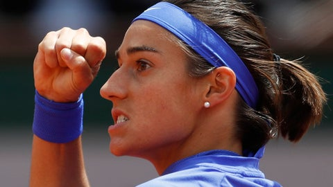 France's Caroline Garcia clenches her fist after scoring a point against Karolina Pliskova of the Czech Republic during their quarterfinal match of the French Open tennis tournament at the Roland Garros stadium, in Paris, France. Wednesday, June 7, 2017. (AP Photo/Petr David Josek)