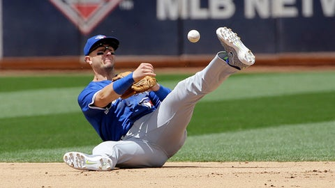 Toronto Blue Jays shortstop Troy Tulowitzki throws to second base on a double play ground ball hit into by Oakland Athletics' Khris Davis during the fifth inning of a baseball game in Oakland, Calif., Wednesday, June 7, 2017. (AP Photo/Jeff Chiu)