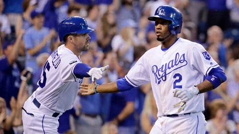 Kansas City Royals shortstop Alcides Escobar (2) celebrates with Whit Merrifield after scoring on a double by Ramon Torres during the fourth inning of a baseball game against the Houston Astros Wednesday, June 7, 2017, in Kansas City, Mo. (AP Photo/Charlie Riedel)