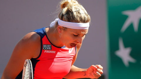 Timea Bacsinszky of Switzerland clenches her fist as she plays Latvia's Jelena Ostapenko during their semifinal match of the French Open tennis tournament at the Roland Garros stadium, Thursday, June 8, 2017 in Paris. (AP Photo/Michel Euler)