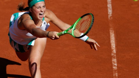 Latvia's Jelena Ostapenko plays a shot against Timea Bacsinszky of Switzerland during their semifinal match of the French Open tennis tournament at the Roland Garros stadium, in Paris, France. Thursday, June 8, 2017. (AP Photo/Petr David Josek)