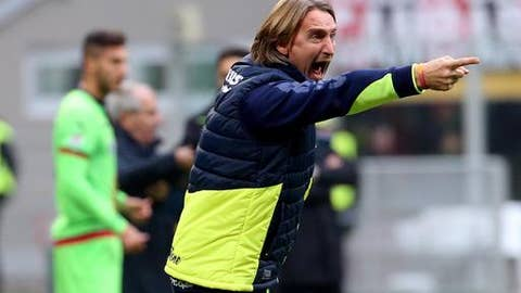 FILE - In this Dec. 4, 2016 file photo, Crotone coach Davide Nicola shouts during the Serie A soccer match between AC Milan and Crotone at the San Siro stadium in Milan, Italy. Crotone coach Davide Nicola will fulfill a promise made two months ago and ride his bike on a 1,300-kilometer (800-mile) trip home _ nearly the full length of boot-shaped Italy _ to celebrate the Calabrian club avoiding relegation.(Matteo Bazzi/ANSA via AP, file)