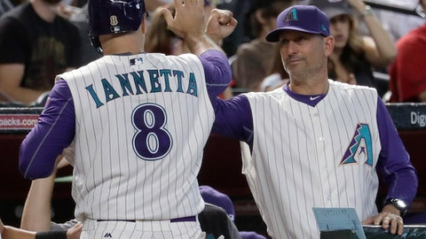 Arizona Diamondbacks catcher Chris Iannetta (8) greets manager Torey Lovullo after scoring on a base hit by Paul Goldschmidt during the sixth inning of a baseball game against the San Diego Padres, Thursday, June 8, 2017, in Phoenix. (AP Photo/Matt York)