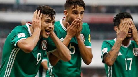 Mexico's Raul Jimenez, left, celebrates with teammates Diego Antonio Reyes, center, and Jesus Corona, after he scored against Honduras during a 2018 Russia World Cup qualifying soccer match at Azteca Stadium in Mexico City, Thursday, June 8, 2017. (AP Photo/Eduardo Verdugo)