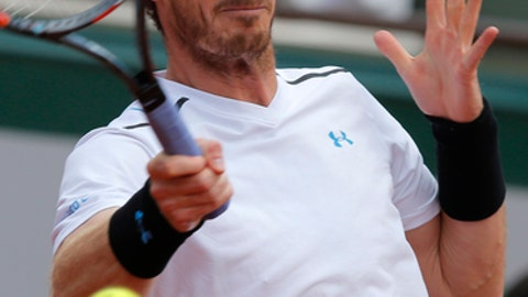 Britain's Andy Murray returns the ball to Switzerland's Stan Wawrinka during their semifinal match of the French Open tennis tournament at the Roland Garros stadium, Friday, June 9, 2017 in Paris. (AP Photo/Michel Euler)