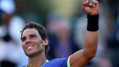 Spain's Rafael Nadal clenches his fist invictory after defeating Austria's Dominic Thiem during their semifinal match of the French Open tennis tournament at the Roland Garros stadium, Friday, June 9, 2017 in Paris. Nadal won 6-3, 6-4, 6-0. (AP Photo/David Vincent)