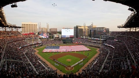U.S. Navy fighter jets fly over SunTrust Park during the national anthem before a baseball game between the Atlanta Braves and the San Diego Padres in Atlanta, Friday, April 14, 2017. This isn't just another opening day in Atlanta. The Braves are playing their first regular-season game in SunTrust Park, the new stadium that replaced Turner Field. (AP Photo/David Goldman)