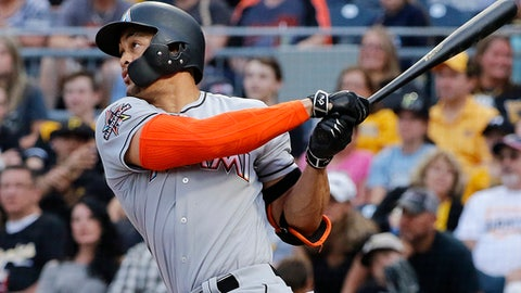 Miami Marlins' Giancarlo Stanton follows through on a solo home run off Pittsburgh Pirates starting pitcher Tyler Glasnow during the third inning of a baseball game in Pittsburgh, Friday, June 9, 2017. (AP Photo/Gene J. Puskar)