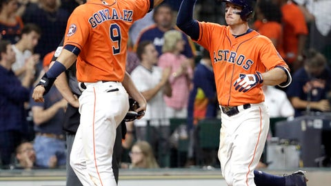 Houston Astros' Alex Bregman (2) celebrates with Marwin Gonzalez (9) after both scored on Bregman's home run against the Los Angeles Angels during the seventh inning of a baseball game Friday, June 9, 2017, in Houston. (AP Photo/David J. Phillip)