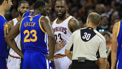 CLEVELAND, OH - JUNE 09: Draymond Green #23 of the Golden State Warriors and LeBron James #23 of the Cleveland Cavaliers react to referee John Goble #30 in Game 4 of the 2017 NBA Finals at Quicken Loans Arena on June 9, 2017 in Cleveland, Ohio. NOTE TO USER: User expressly acknowledges and agrees that, by downloading and or using this photograph, User is consenting to the terms and conditions of the Getty Images License Agreement.  (Photo by Ronald Martinez/Getty Images)