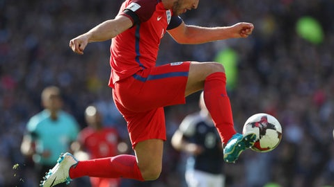 England's Harry Kane scores his side's second goal during the World Cup Group F qualifying soccer match between Scotland and England at Hampden Park, Glasgow, Scotland, Saturday, June 10, 2017. (AP Photo/Scott Heppell)