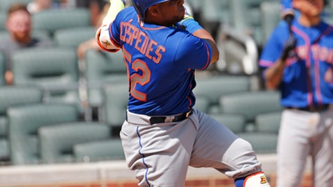 New York Mets left fielder Yoenis Cespedes (52) follows through on a grand slam in the ninth inning of a baseball game against the Atlanta Braves Saturday, June 10, 2017, in Atlanta. It was the first game of a double header. (AP Photo/John Bazemore)