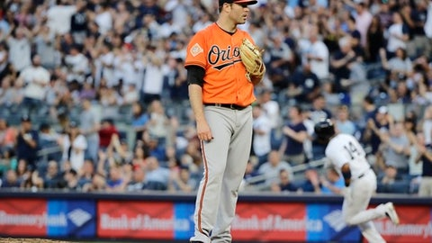 Baltimore Orioles starting pitcher Chris Tillman, foreground, reacts as New York Yankees' Starlin Castro runs the bases after hitting a three-run home run during the second inning of a baseball game Saturday, June 10, 2017, in New York. (AP Photo/Frank Franklin II)