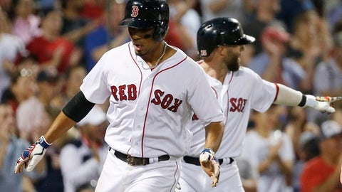 Boston Red Sox's Xander Bogaerts, left, and Dustin Pedroia celebrate after scoring on a two-run double by Mitch Moreland during the seventh inning of a baseball game against the Detroit Tigers, Saturday, June 10, 2017, in Boston. (AP Photo/Michael Dwyer)
