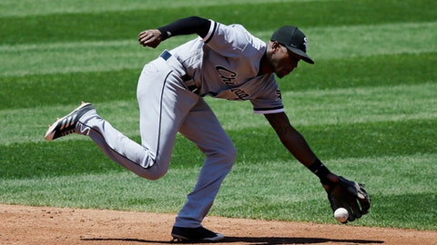 Chicago White Sox's Tim Anderson fields a ball hit by Cleveland Indians' Daniel Robertson in the third inning of a baseball game, Sunday, June 11, 2017, in Cleveland. Robertson was out on the play. (AP Photo/Tony Dejak)