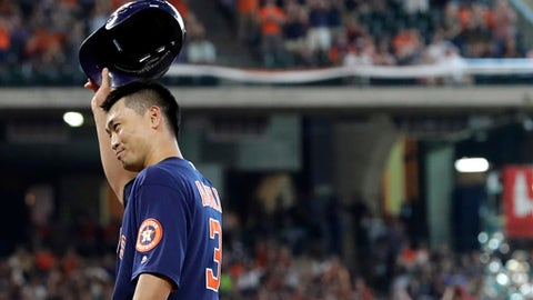 Houston Astros' Norichika Aoki (3) tips his helmet after hitting a single during the sixth inning of a baseball game against the Los Angeles Angels, Sunday, June 11, 2017, in Houston. Aoki's single was his 2,000th career hit in between the major leagues and in Japan's top league. The mark garners automatic entrance into the Meikyukai, The Golden Players Club, which is one of two Japanese baseball halls of fame. (AP Photo/David J. Phillip)
