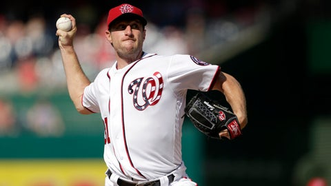 CORRECTS TO FOURTH INNING NOT THIRD Washington Nationals starting pitcher Max Scherzer throws a strike for his 2000th career strike out during the fourth inning of a baseball game, Sunday, June 11, 2017, in Washington. (AP Photo/Mark Tenally)