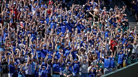 "Fans, many wearing Toronto Blue Jays' blue shirts, stand as a ""wave"" rolls through the stadium in the seventh inning of a baseball game against the Seattle Mariners, Sunday, June 11, 2017, in Seattle. (AP Photo/Elaine Thompson)"