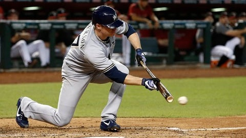Milwaukee Brewers' Chase Anderson puts down a sacrifice bunt against the Arizona Diamondbacks during the fifth inning of a baseball game, Sunday, June 11, 2017, in Phoenix. (AP Photo/Ross D. Franklin)
