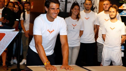 Spain's Rafael Nadal smiles during a handprints event on the Champs Elysees avenue in Paris, France, Monday, June 12, 2017. Nadal defeated Switzerland's Stan Wawrinka in the men's final at the French Open tennis championships on Sunday. (AP Photo/Francois Mori)