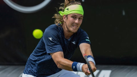 Slovakia's Lukas Lacko  returns a shot to Germany's Jan-Lennard Struff at the Mercedes Cup ATP tennis tournament in Stuttgart, Germany, Monday, June 12, 2017. (Daniel Maurer/dpa via AP)