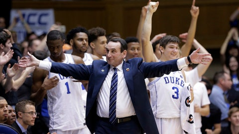 FILE - In this Thursday, Feb. 9, 2017, file photo, Duke coach Mike Krzyzewski reacts as time expires during the second half of the team's 86-78 win in an NCAA college basketball game against North Carolina, in Durham, N.C. Duke athletic director Kevin White is looking forward to a better, and healthier, 2017-18 for all of his school's athletic teams. In fact, Hall of Fame men's basketball coach Mike Krzyzewski missed a month after having back surgery, and three freshman forwards each missed significant time with knee, foot and ankle injuries. (AP Photo/Gerry Broome, File)