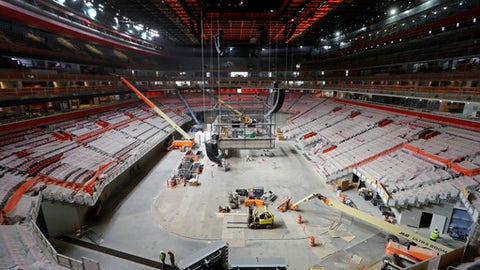 Construction continues on Little Caesars Arena in Detroit, Monday, June 12, 2017. The arena scheduled to open in September will be home to the NHL hockey Detroit Red Wings and NBA basketball Detroit Pistons. (AP Photo/Paul Sancya)