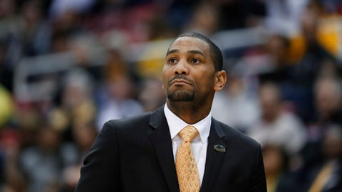 Milwaukee head coach LaVall Jordan watches against the Northern Kentucky in the second half of the Horizon League NCAA college basketball tournament championship game in Detroit, Tuesday, March 7, 2017. (AP Photo/Paul Sancya)