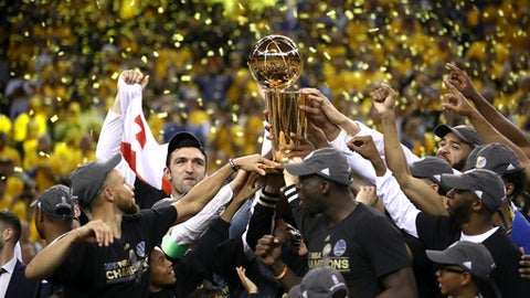 OAKLAND, CA - JUNE 12:  The Golden State Warriors celebrate with the Larry O'Brien Championship Trophy after defeating the Cleveland Cavaliers 129-120 in Game 5 to win the 2017 NBA Finals at ORACLE Arena on June 12, 2017 in Oakland, California. NOTE TO USER: User expressly acknowledges and agrees that, by downloading and or using this photograph, User is consenting to the terms and conditions of the Getty Images License Agreement.  (Photo by Ezra Shaw/Getty Images)