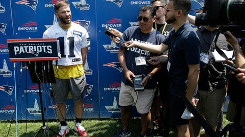 New England Patriots wide receiver Julian Edelman, left, speaks with members of the media following NFL football practice, Tuesday, June 13, 2017, in Foxborough, Mass. (AP Photo/Steven Senne)