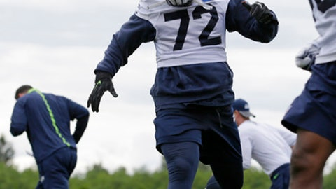 Seattle Seahawks defensive end Michael Bennett runs an agility drill during NFL football practice, Tuesday, June 13, 2017, in Renton, Wash. (AP Photo/Ted S. Warren)