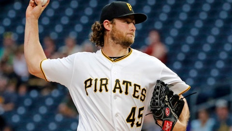 Pittsburgh Pirates starting pitcher Gerrit Cole delivers in the first inning of a baseball game against the Colorado Rockies in Pittsburgh, Tuesday, June 13, 2017. (AP Photo/Gene J. Puskar)