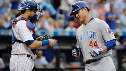 Chicago Cubs' Anthony Rizzo (44) runs past New York Mets catcher Travis d'Arnaud after hitting a home run during the first inning of a baseball game Tuesday, June 13, 2017, in New York. (AP Photo/Frank Franklin II)